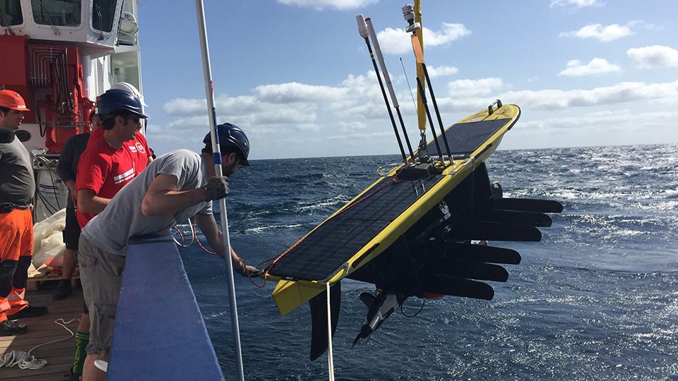 A WaveGlider is deployed off the research vessel Maria S. Merian.