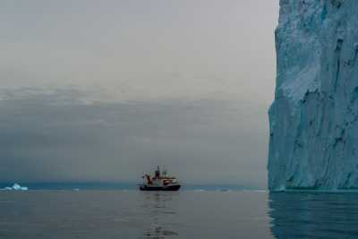 RV Polarstern with Iceberg and Helicopter during PS104